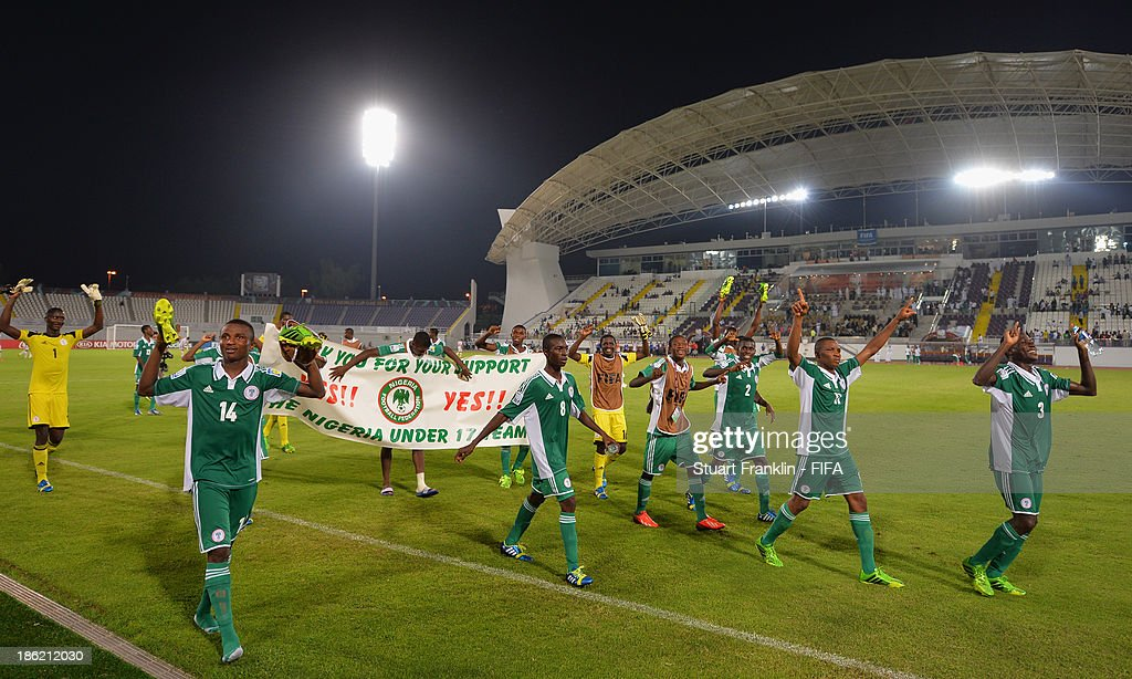 The players of Nigeria celebrate their teams win at the end of the round of 16 match between Nigeria and Iran at Khalifa Bin Zayed Stadium on October 29, 2013 in Al Ain, United Arab Emirates.