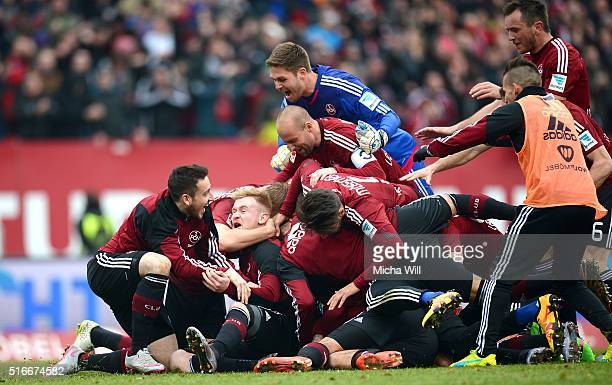 The players of Nuernberg celebrate their team's third goal scored by Guido Burgstaller of Nuernberg during the Second Bundesliga match between 1 FC...
