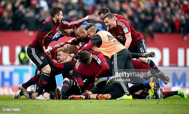 The players of Nuernberg celebrate their teams third goal scored by Guido Burgstaller of Nuernberg during the Second Bundesliga match between 1 FC...