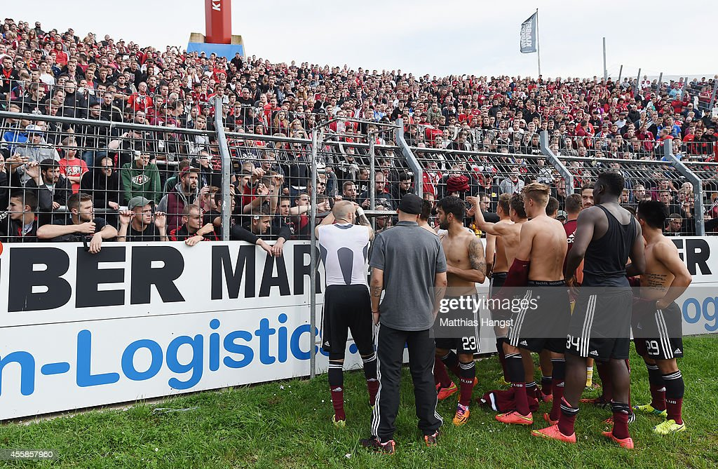 The players of Nuernberg hand over their jerseys to the fans after the Second Bundesliga match between Karlsruher SC and 1 FC Nuernberg at Wildpark...