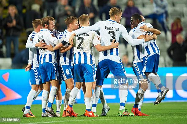 The players of OB Odense celebrating after the Danish Alka Superliga match between OB Odense and AGF Arhus at TREFOR Park on September 30 2016 in...