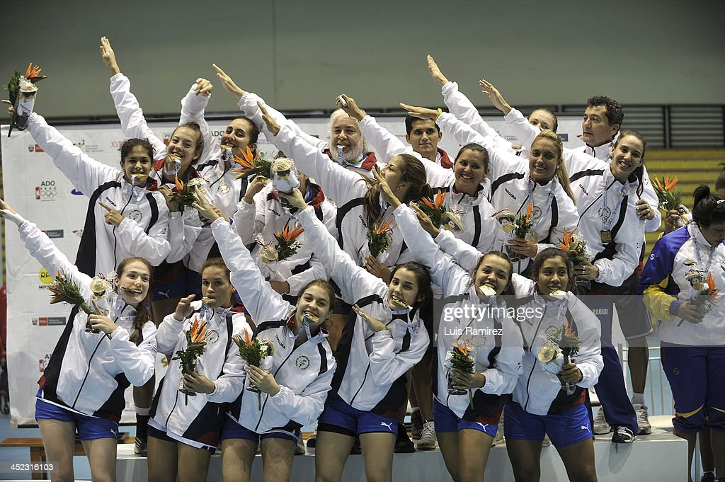 The players of Paraguay celebrate the title during a match between Paraguay and Chile in Women's handball as part of the XVII Bolivarian Games Trujillo 2013 at Colegio San Agustin on November 27, 2013 in Chiclayo, Peru.