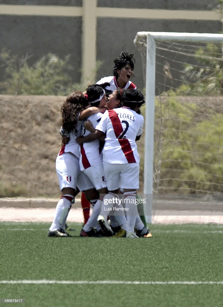 The players of Peru celebrate a goal scored during a match between Peru and Ecuador in Women's U-20 football Qualifiers as part of the XVII Bolivarian Games Trujillo 2013 at Colegio San Jose on November 17, 2013 in Chiclayo, Peru.