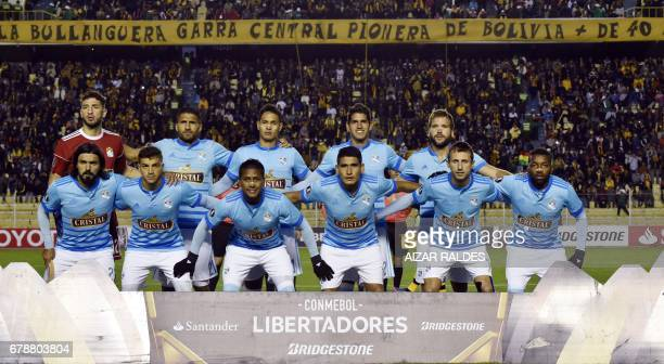 The players of Peru's Sporting Cristal pose before their Copa Libertadores football match against Bolivia's The Strongest at Hernando Siles Stadium...