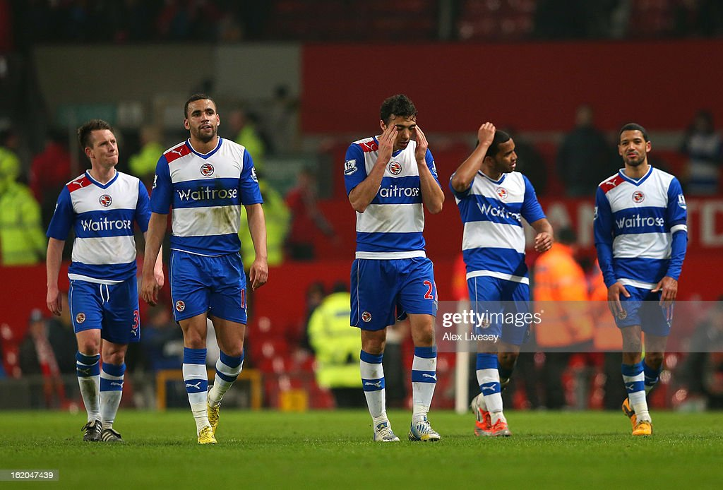 The players of Reading leave the pitch after defeat to Manchester United in the FA Cup Fifth Round match between Manchester United and Reading at Old Trafford on February 18, 2013 in Manchester, England.