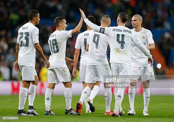 The players of Real Madrid celebrate after scoring during the La Liga match between Real Madrid CF and Rayo Vallecano at Estadio Santiago Bernabeu on...