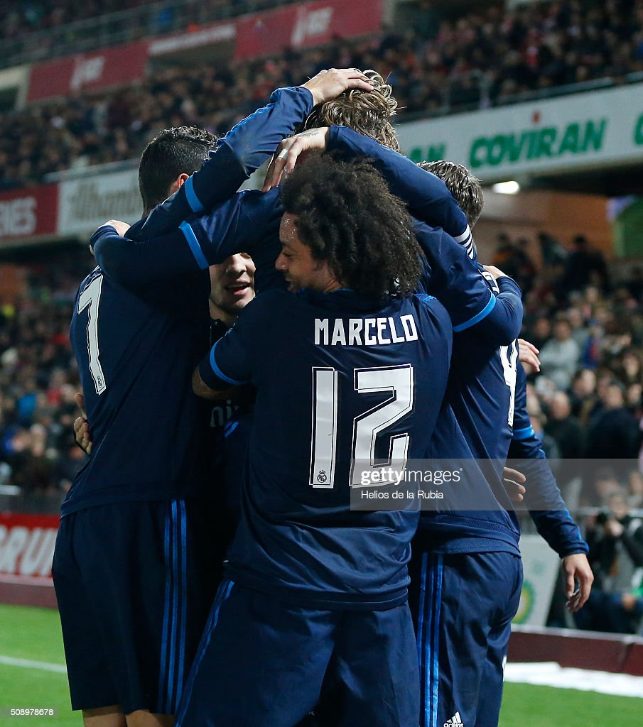 The players of Real Madrid celebrate after scoring during the La Liga match between Granada CF and Real Madrid CF at Nuevo Estadio de Los Carmenes on February 7, 2016 in Granada, Spain.