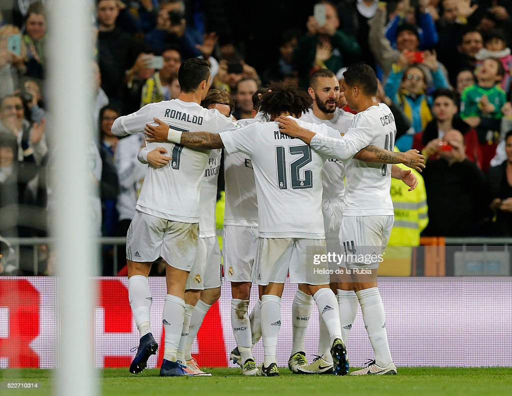 The players of Real Madrid celebrate after scoring during the La Liga match between Real Madrid CF and Villarreal CF at Estadio Santiago Bernabeu on April 20, 2016 in Madrid, Spain.