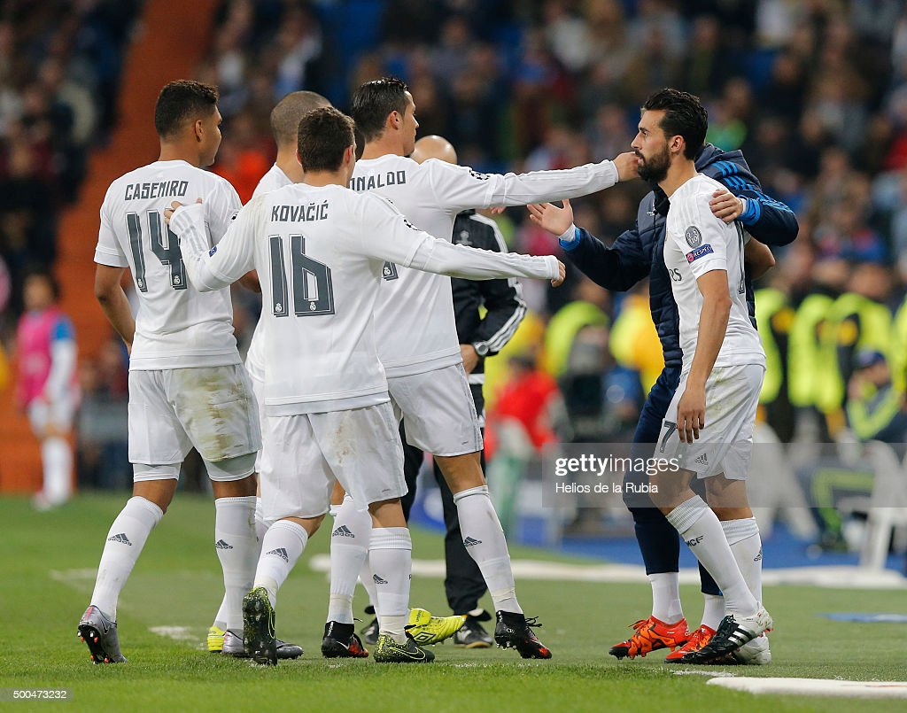 The players of Real Madrid celebrate after scoring during the UEFA Champions League Group A match between Real Madrid and Malmo FF at Estadio Santiago Bernabeu on December 8, 2015 in Madrid, Spain.
