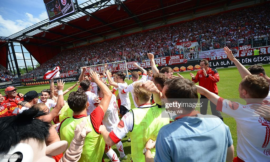 The players of Regensburg celebrate after winning the Third League play off second leg match between Jahn Regensburg and VfL Wolfsburg II at Continental Arena on May 29, 2016 in Regensburg, Germany.