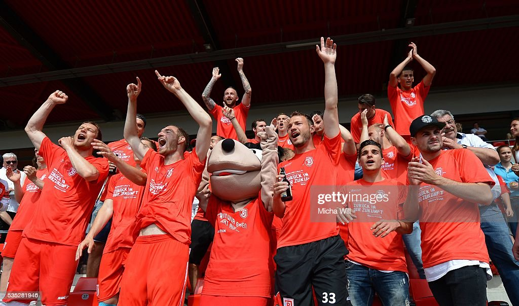 The players of Regensburg celebrate their teams victory in the Third League play off second leg match between Jahn Regensburg and VfL Wolfsburg II at Continental Arena on May 29, 2016 in Regensburg, Germany.