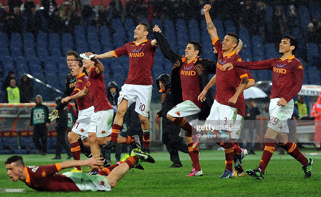 The players of Roma celebrate victory after the Serie A match between AS Roma and Parma FC at Stadio Olimpico on March 17, 2013 in Rome, Italy.