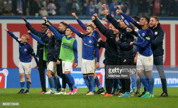 The players of Rostock celebrate with their supporters after winning the third league match between FC Hansa Rostock and VfL Osnabrueck at...