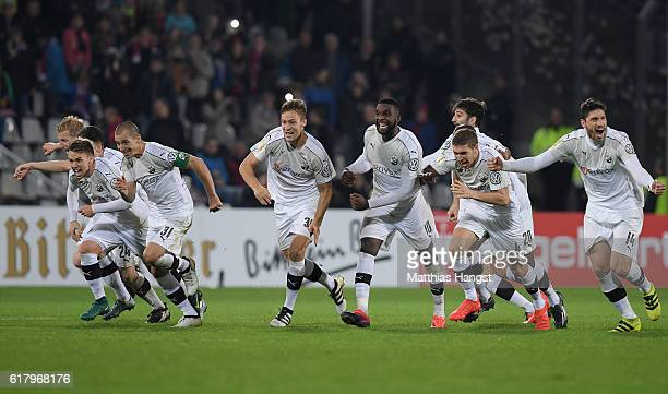 The players of Sandhausen celebrate after winning the penalty shootout during the DFB Cup match between SC Freiburg and SV Sandhausen at...