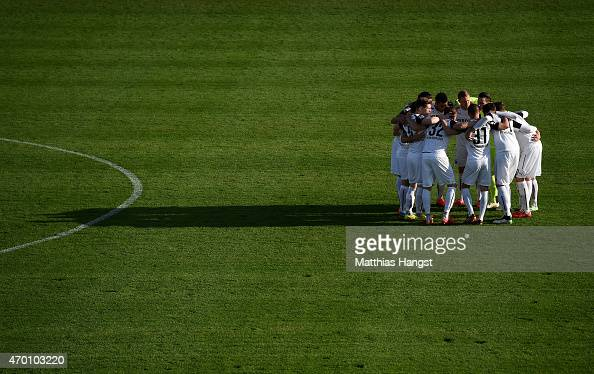 The players of Sandhausen motivate each over prior to the Second Bundesliga match between SV Sandhausen and Karlsruher SC at Hardtwaldstadion on...