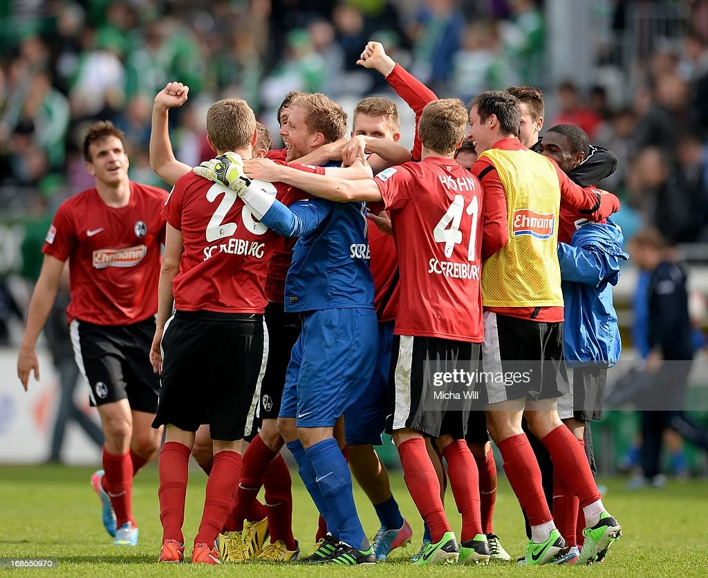 The players of SC Freiburg celebrate their win after the Bundesliga match between SpVgg Greuther Fuerth and SC Freiburg at Trolli-Arena on May 11, 2013 in Fuerth, Germany.
