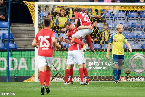 The players of Silkeborg IF celebrate after the 01 goal from Gustaf Nilsson of Silkeborg IF during the Danish Alka Superliga match between Brondby IF...