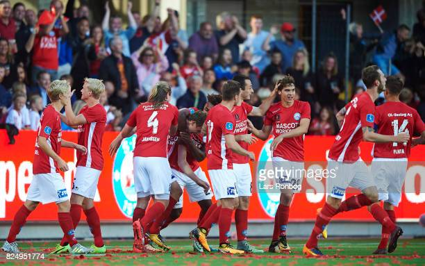 The players of Silkeborg IF celebrate after the 10 goal scored by Gustaf Nilsson of Silkeborg IF during the Danish Alka Superliga match between...