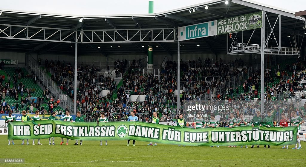 The players of SpVgg Greuther Fuerth bid farewell to their fans showing a banner after the Bundesliga match between SpVgg Greuther Fuerth and SC Freiburg at Trolli-Arena on May 11, 2013 in Fuerth, Germany.