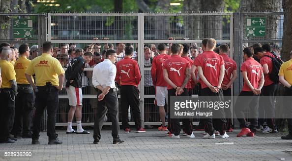 The players of Stuttgart discuss with fans at the stadium exit after the Bundesliga match between VfB Stuttgart and 1 FSV Mainz 05 at MercedesBenz...