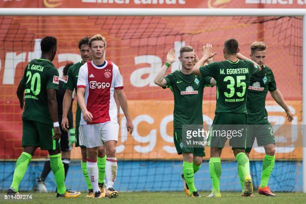 the players of SV Werder Bremen celebrate the goal of Florian Kainz of SV Werder Bremen during the friendly match between Ajax Amsterdam and SV...