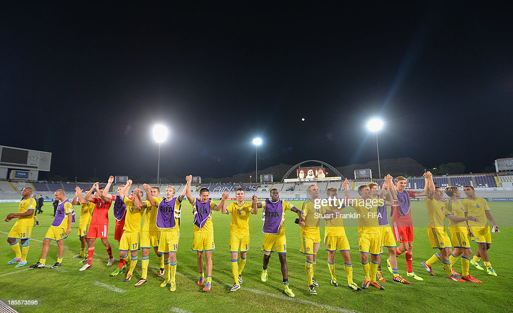 The players of Sweden celebrate at the end of the FIFA U17 group F match between Sweden and Nigeria at Khalifa Bin Zayed Stadium on October 22, 2013 in Al Ain, United Arab Emirates.
