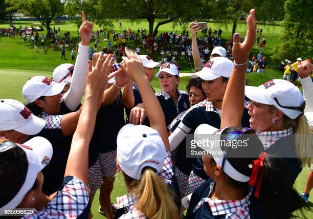 The players of Team USA celebrate after the final day singles matches of The Solheim Cup at Des Moines Golf and Country Club on August 20 2017 in...