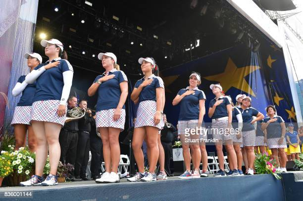 The players of Team USA stand for the national anthem during the closing ceremony after the final day singles matches of The Solheim Cup at Des...
