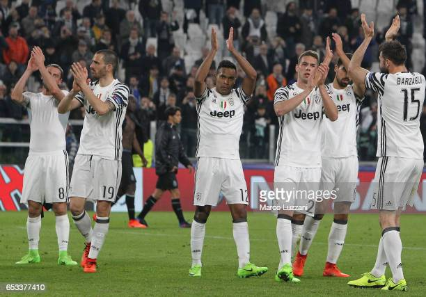 The players of the Juventus celebrate a victory at the end of the UEFA Champions League Round of 16 second leg match between Juventus and FC Porto at...