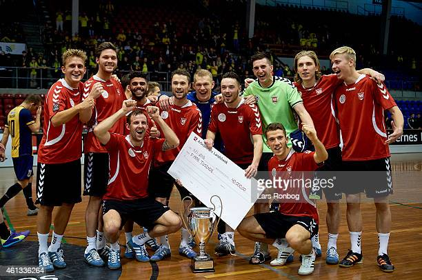 The players of Vejle Boldklub wins the final and celebrate after the Arbejdernes Landsbank Cup at Brondby Hallen on January 11 2015 in Brondby Denmark