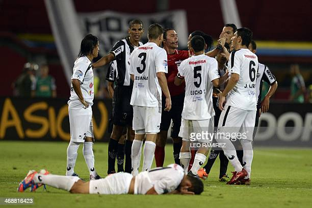 The players of Venezuela's Zamora argue with the refree during their Libertadores Cup match against Brazilian Atletico Mineiro in Barinas Venezuela...