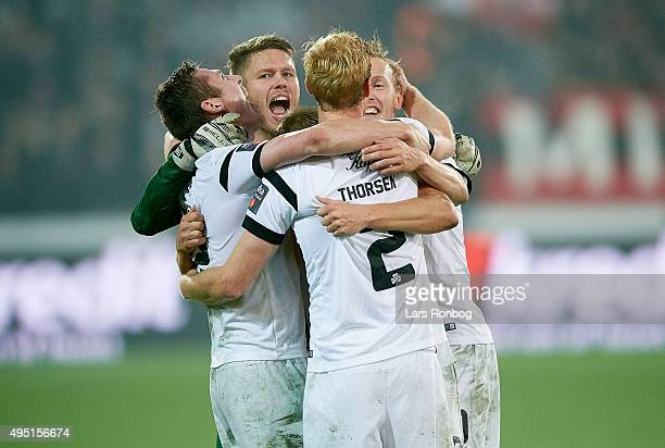 The players of Viborg FF celebrate after the Danish Alka Superliga match between FC Midtjylland and Viborg FF at MCH Arena on October 31 2015 in...