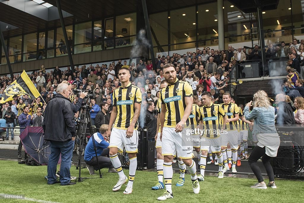 the players of Vitesse enter the pitch for the forst training (L-R) Kevin Diks of Vitesse, Guram Kashia of Vitesse during the first training session of the season 2016/2017 on June 26, 2016 at Papendal, The Netherlands