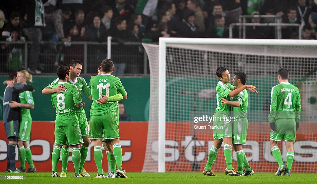 The players of Wolfsburg celebrate at the end of the round of 16 of the DFB cup match between VfL Wolfsburg and Bayer Leverkusen at Volkswagen Arena on December 19, 2012 in Wolfsburg, Germany.