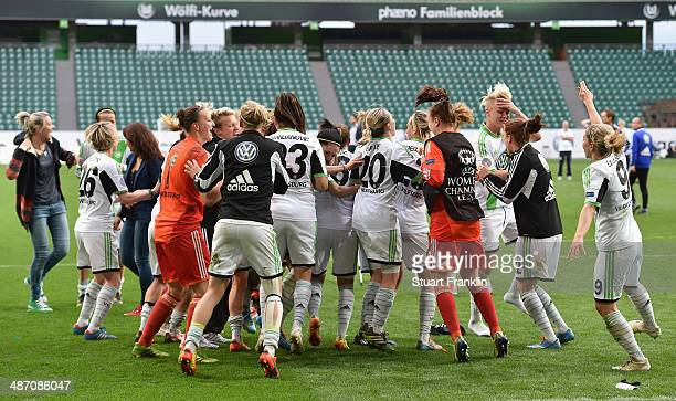 The players of Wolfsburg celebrate their win at the end of the UEFA Women's Champions League semi final second leg match between VfL Wolfsburg and 1...