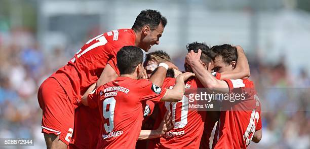 The players of Wuerzburg celebrate their team's first goal scored by Marco Haller of Wuerzburg during the Third League match between Wuerzburger...