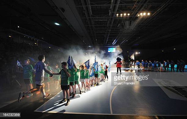 The players run onto the court at the start of the hanball Champions League game between HSV Hamburg and Celje Pivovarna Lasko at the sport hall on...