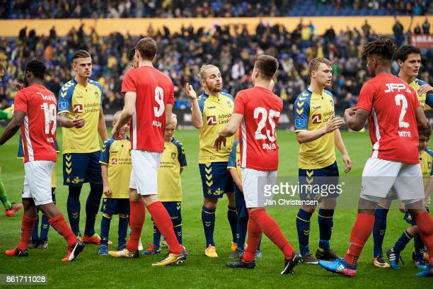 The players shake hands prior to the Danish Alka Superliga match between Brondby IF and Silkeborg IF at Brondby Stadion on October 15 2017 in Brondby...