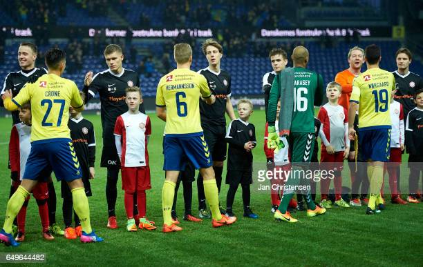 The players shake hands prior to the Danish Cup DBU Pokalen match between BK Marienlyst and Brondby IF at Brondby Stadion on March 08 2017 in Brondby...