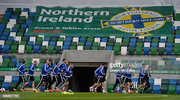 The players take part in a warm up drill as the Northern Ireland international football squad hold a training session at Windsor Park on November 12...