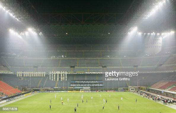 The players wait for Kick Off in front of an empty San Siro after a UEFA Ban on supporters attending during the UEFA Champions League Group H match...