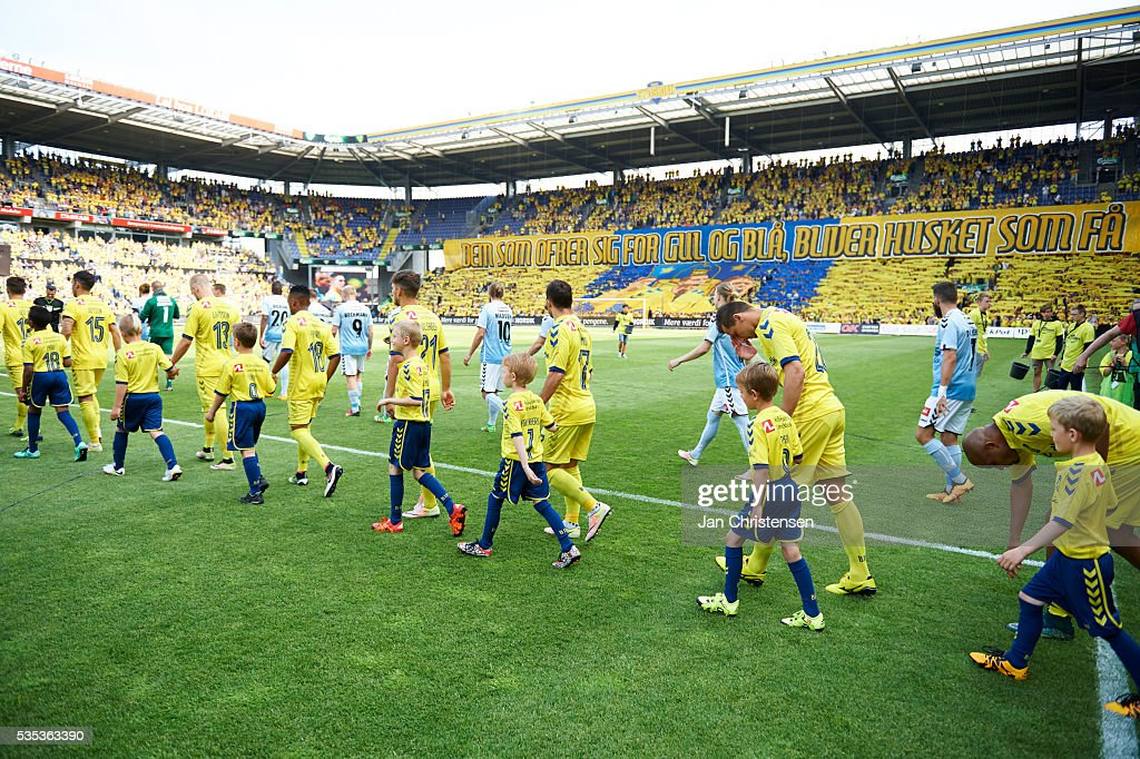 The players walk on to the pitch prior to the Danish Alka Superliga match between Brondby IF and SonderjyskE at Brondby Stadion on May 29, 2016 in Brondby, Denmark.