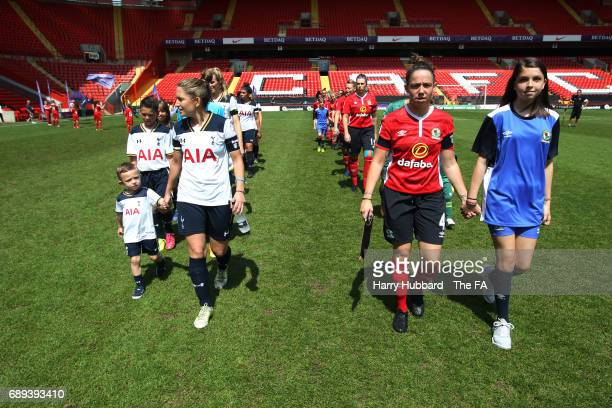 The players walk onto the pitch for the FA Women's Premier League Playoff Final between Tottenham Hotspur Ladies and Blackburn Rovers Ladies at The...