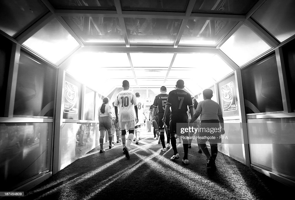 The players walk out of the tunnel during the FIFA U-17 World Cup UAE 2013 Final between Nigeria and Mexico at the Mohamed Bin Zayed Stadium on November 8, 2013 in Abu Dhabi, United Arab Emirates.