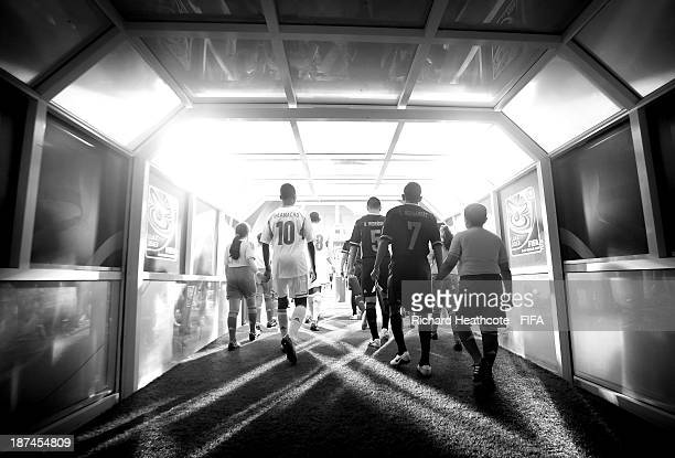The players walk out of the tunnel during the FIFA U17 World Cup UAE 2013 Final between Nigeria and Mexico at the Mohamed Bin Zayed Stadium on...