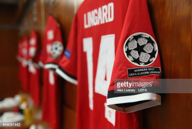 The playing shirts of Manchester United are seen hanging in their dressing room prior to the UEFA Champions League group A match between Manchester...