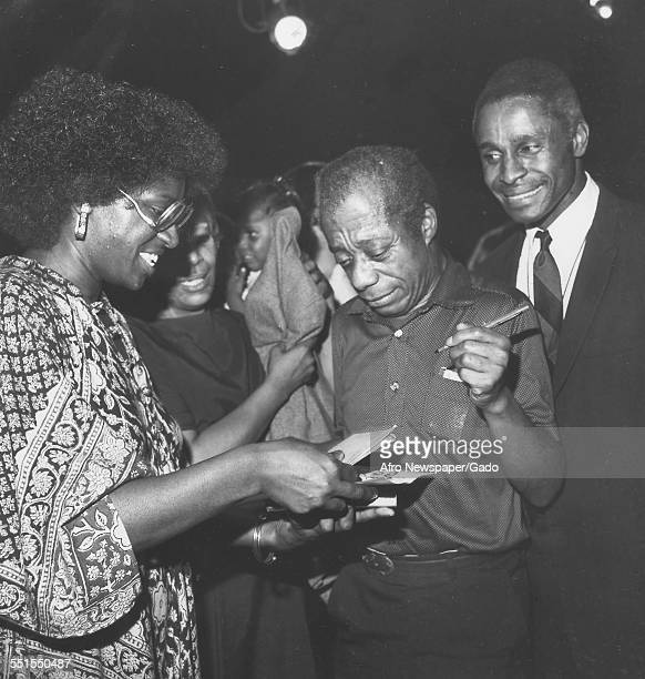 The playwright James Baldwin author of Blues for Mr Charlie a play in New York city signing books for fans with Percy Thomas the lead actor New York...