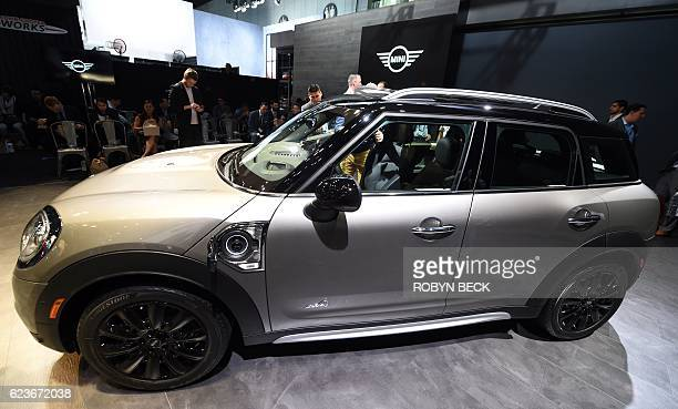 The plugin hybrid 2017 Mini Cooper Countryman SE allwheel drive is displayed during the BMW AG Mini press conference at the 2016 Los Angeles Auto...