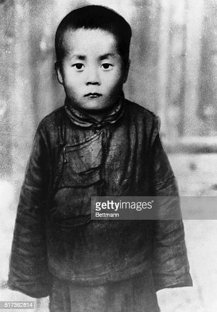 The plump peasant boy of six whose name is Lingerh Lamutanchu and who was to have been enthroned as the fourteenth Dalai Lama spiritual and temporal...
