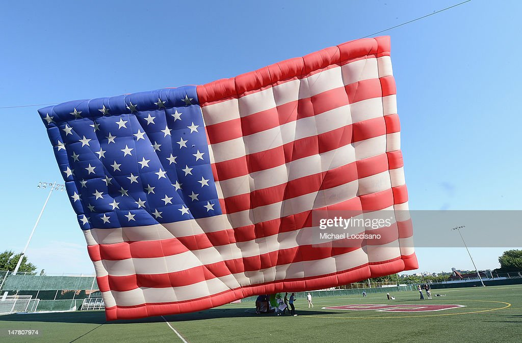The PNC American Flag balloon is inflated in honor of America for Independence Day on the De Baun Athletic Complex at Stevens Institute of Technology on July 3, 2012 in Hoboken, New Jersey. The 53 by 78 foot balloon is the world's largest free-flying American flag, weighs 530 pounds and is being flown in the upcoming 30th annual NJ Festival of Ballooning.
